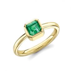 Стильное кольцо с изумрудом из желтого золота