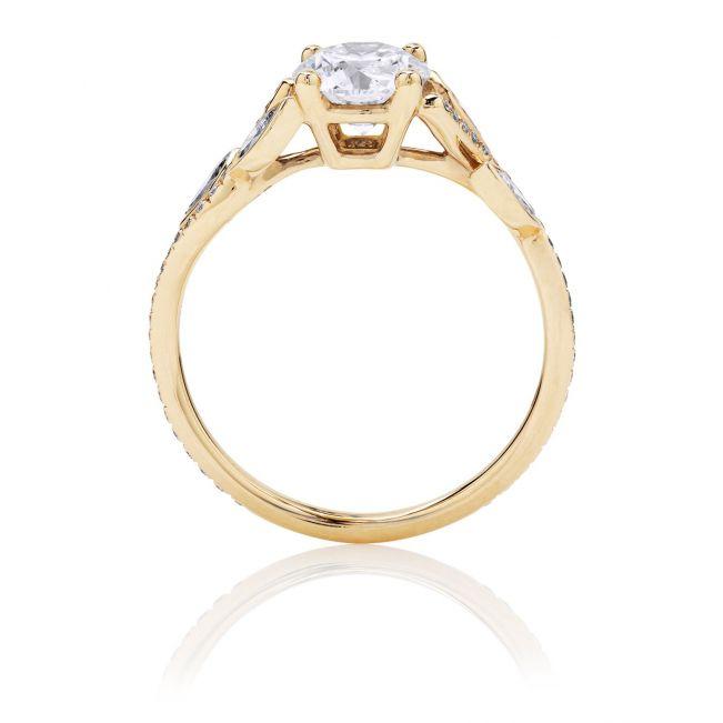Кольцо с бриллиантом и веточками по бокам