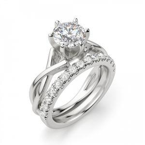 Кольцо перекрученное из белого золота с бриллиантом