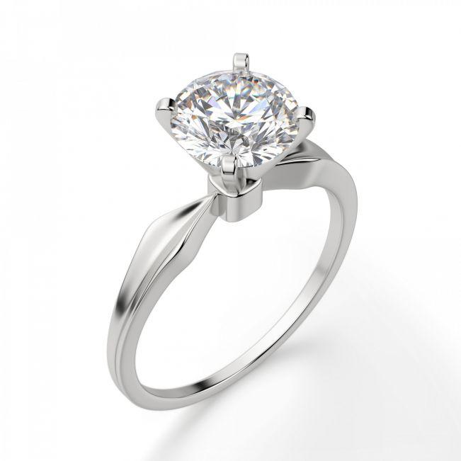 Кольцо с сужающейся шинкой и высокой закрепкой бриллианта