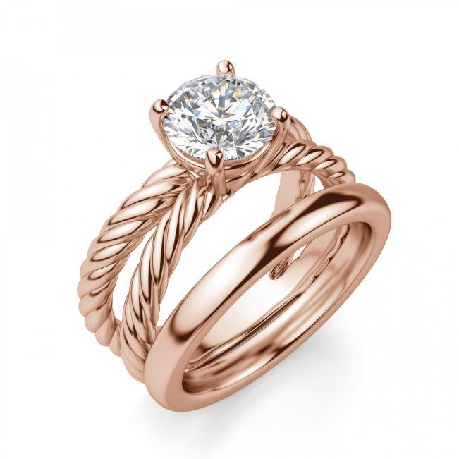 Переплетеное кольцо из розового золота с бриллиантом