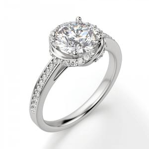 Кольцо с бриллиантом в закрученном ореоле