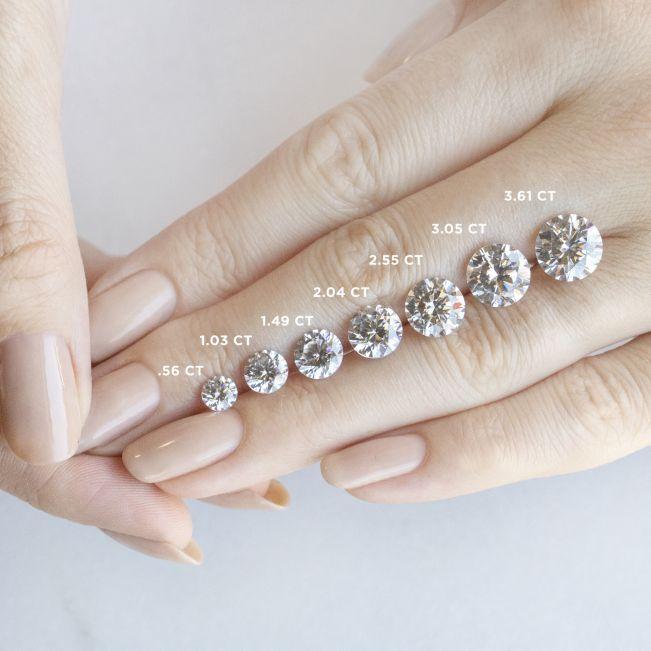 Кольцо двойное из розового золота с круглым бриллиантом