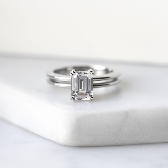 Кольцо двойное с бриллиантом изумрудной огранки - Фото 4
