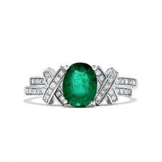 Кольцо с овальным изумрудом и бриллиантовыми элементами