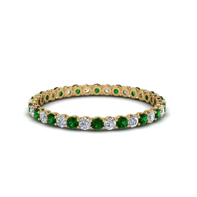 Кольцо дорожка из золота с изумрудами и бриллиантами